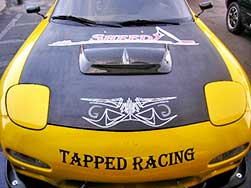 Yellow Mazda with racing decals